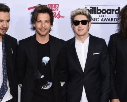 One Direction deny they will be 'taking a break' after tour